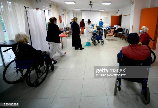 Residents of the Anni Azzurri elderly care home in Rome wait to receive a dose of the Pfizer-BioNTech COVID-19 vaccine as part of the coronavirus...