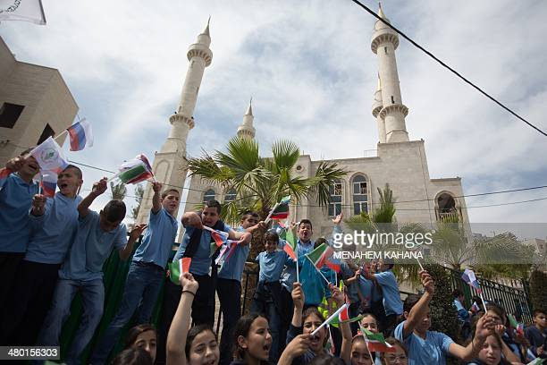 Residents of the Arab Israeli town of Abu Ghosh wave the Chechen flag during the dedication ceremony the new Akhmad Kadyrov mosque on March 23 2014...