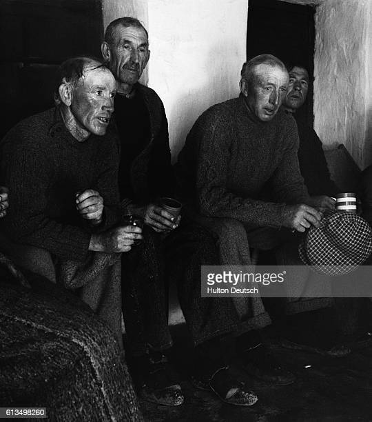Residents of the Aran Islands hold a hearty singsong to welcome Robert Flaherty back to the island 15 years after the filming of Man of Aran which...