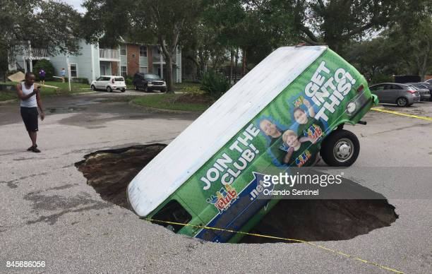 Residents of the Astor Park apartment complex off Tuskawilla Road in Winter Springs Fla were shocked to find a van head first in a sinkhole in the...