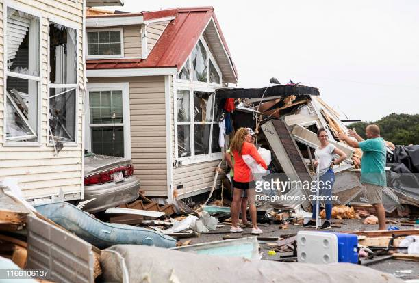 Residents of the Boardwalk RV Park in Emerald Isle, N.C., discuss the path of Hurricane Dorian's waterspout after it ripped through their community...