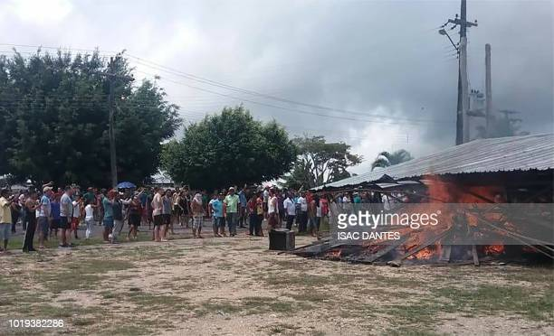 Residents of the Brazilian border town of Pacaraima burn one of the main makeshift camps of Venezuelans immigrants and leading them to cross the...