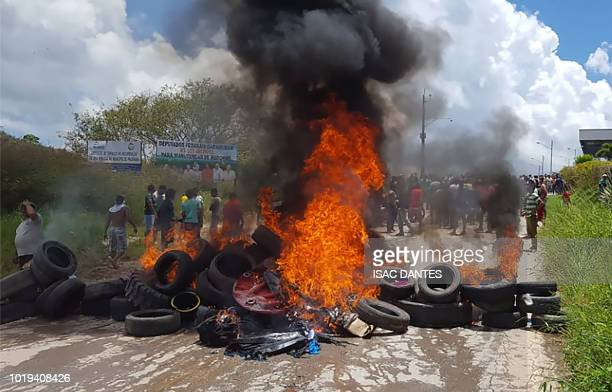 Residents of the Brazilian border town of Pacaraima burn tyres and belongings of Venezuelans immigrants after attacking their two main makeshift...