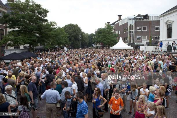 Residents of the city of Leeuwarden gather as they wait to hear the results of the election of the European Capital of Culture 2018 at the Governor's...