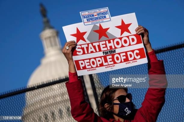 Residents of the District of Columbia rally for statehood near the U.S. Capitol on March 22, 2021 in Washington, DC. On Monday, the House Oversight...