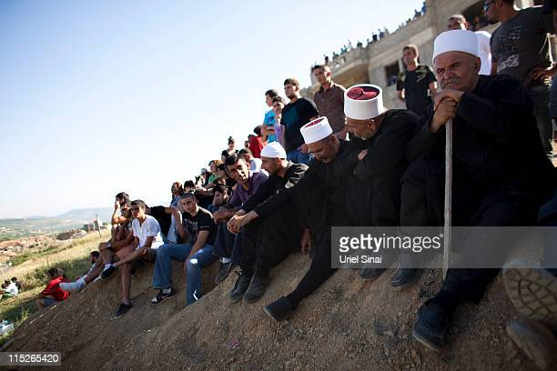 Residents of the Druze village of Majdal Shams in the Israeli-annexed Golan Heights watch as Pro-Palestinian demonstrators storm a ceasefire line, on...