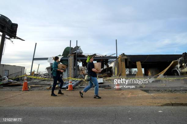 Residents of the East Nashville neighborhood are seen surveying the damage on March 03 2020 in Nashville Tennessee At least 22 people have reportedly...