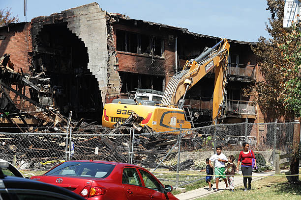 Sixth body recovered after explosion at maryland apartment complex residents of the flower branch apartments walk past the section of the complex that exploded and mightylinksfo