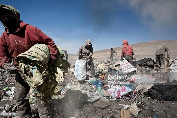 Residents of the ger districts collect recyclable and resellable materials from a trash dump in Ulaanbaatar Unemployment in the ger districts hovers...