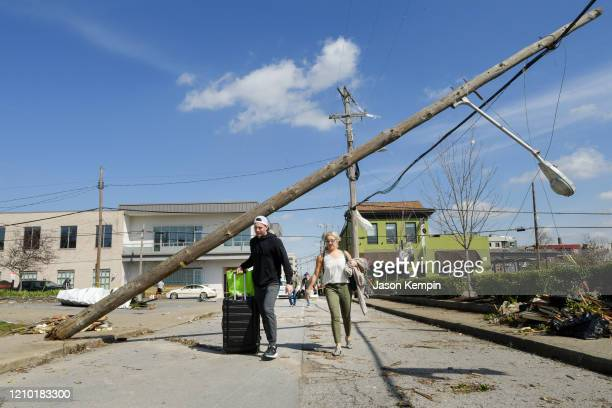 Residents of the Germantown neighborhood leave their apartments with their belongings following devastating tornadoes on March 03 2020 in Nashville...