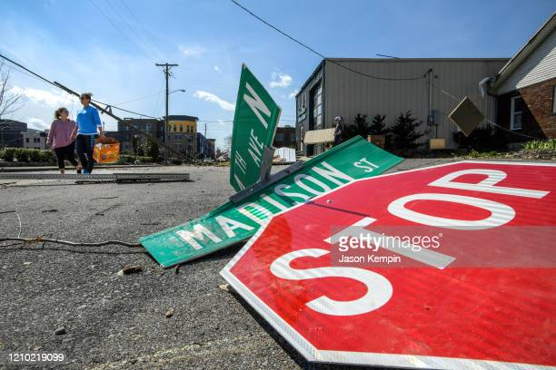 Residents of the Germantown neighborhood survey the damage on the streets on March 03 2020 in Nashville Tennessee At least 22 people have reportedly...