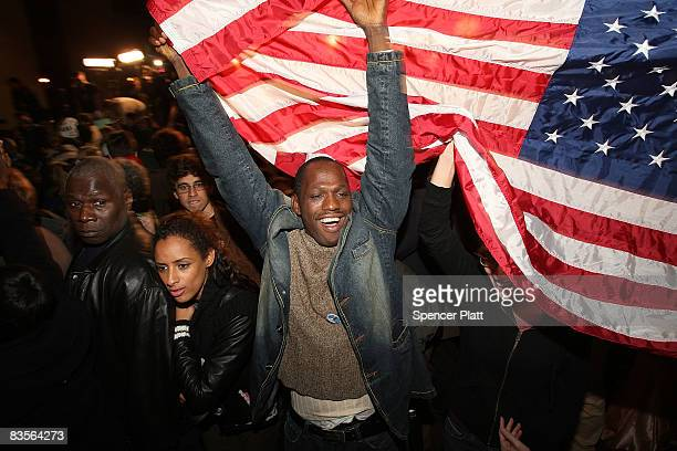 Residents of the historically AfricanAmerican neighborhood of Harlem celebrate at a Democratic rally as they watch live coverage of the election...