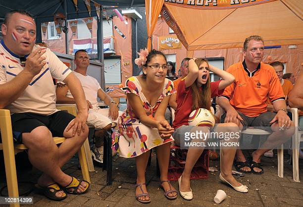 Residents of the Hyacinthen street in Maastricht watch the 2010 FIFA World Cup final between The Netherlands and Spain AFP PHOTO / ANP / MARCEL VAN...