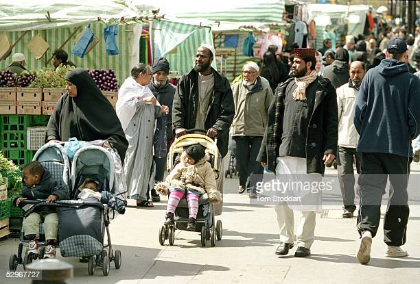 Residents of the multicultural Bethnal Green area of London on market day in Whitechapel High Street