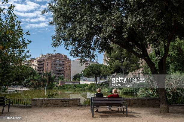 Residents of the neighbourhood sit in the surroundings of the Basilica of the Sagrada Familia without tourists due to the contagion of the Covid. The...