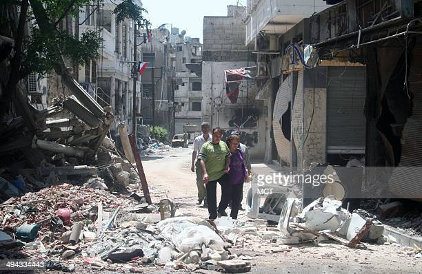 Residents of the Old City of Homs returning to survey the damage to their homes three weeks after a truce and rebel withdrawal ended a devastating...