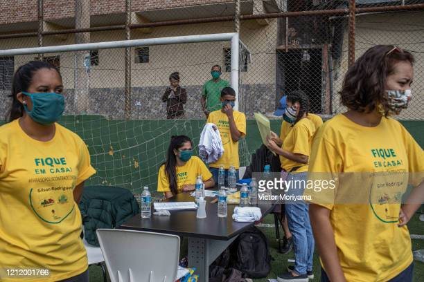 Residents of the Paraisópolis slum provide first aid training on May 6 2020 in Sao Paulo Brazil The local community organizes itself to fight...
