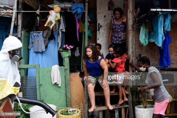 Residents of the Santa Marta favela in Botafogo in the South Zone of Rio start on April 10 2020 to work on cleaning the areas of the community on...