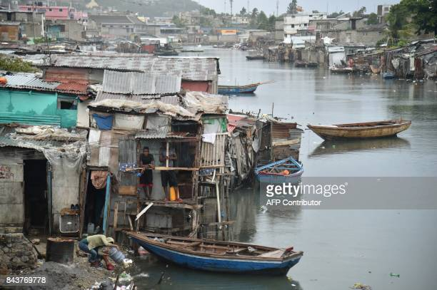 TOPSHOT Residents of the Shada neighborhood in CapHaitien on September 7 as Hurricane Irma approaches Irma was packing maximum sustained winds of up...