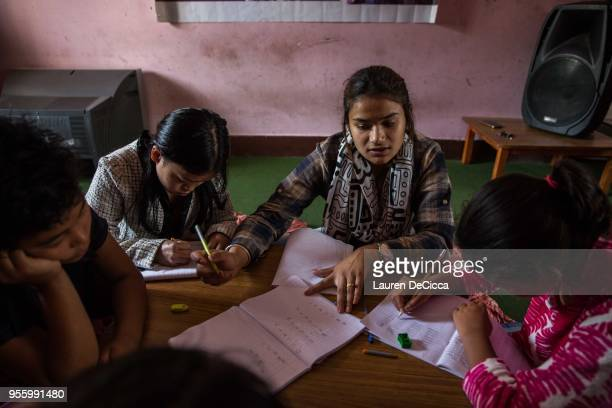 Residents of the Shakti Samuha safe house take part in informal education classes with their teacher Shilpa KC on May 8 2018 in Kathmandu Nepal...