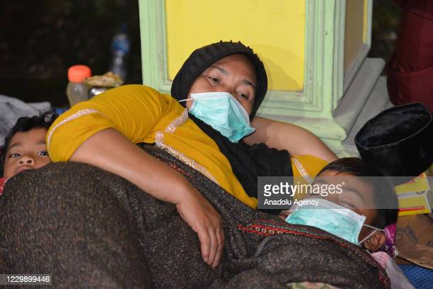 Residents of the slopes of Mount Semeru fled in the village hall of Supiturang, Lumajang, East Java, Indonesia on December 1, 2020. At least 550...
