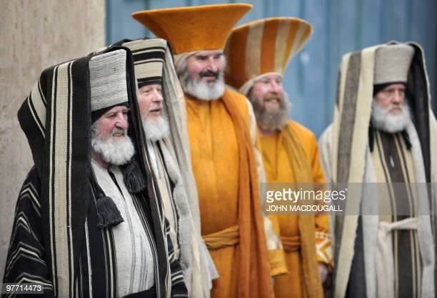 Residents of the small Bavarian village of Oberammergau playing the roles of Jewish high priests line up for a photograph during rehearsals for a...