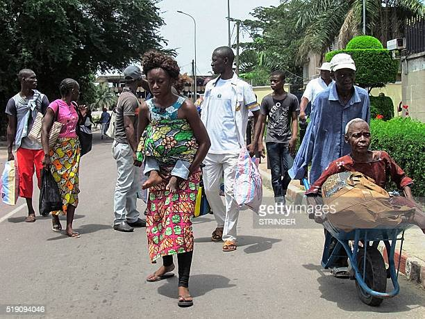 Residents of the southern districts of Brazzaville flee clashes between Congolese security forces and unknown assailants on April 4 2016 Fighting...