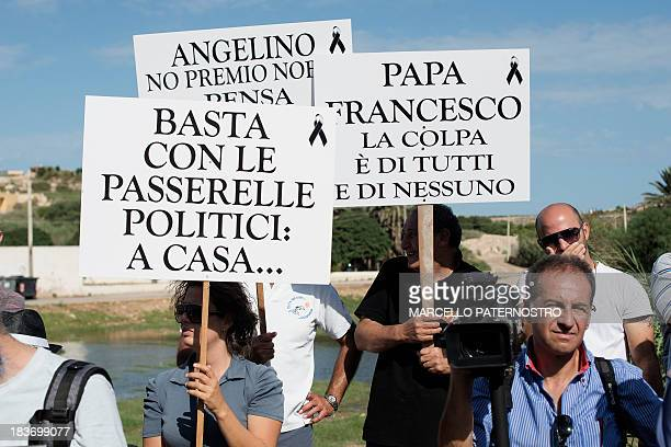 Residents of the southern Italian island of Lampedusa protest on October 9, 2013 against the visit of European Commission chief Jose Manuel Barroso...