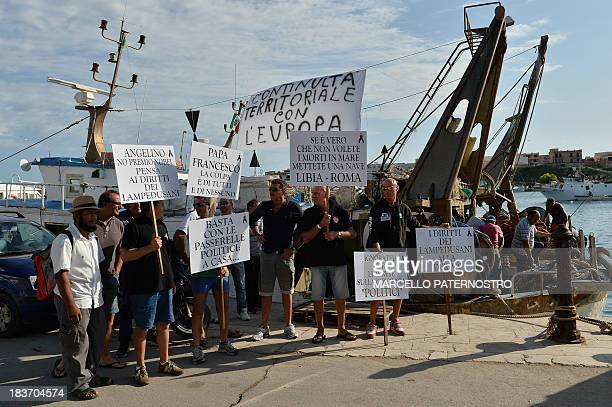 Residents of the southern Italian island of Lampedusa protest on October 9 2013 against the visit of European Commission chief Jose Manuel Barroso...