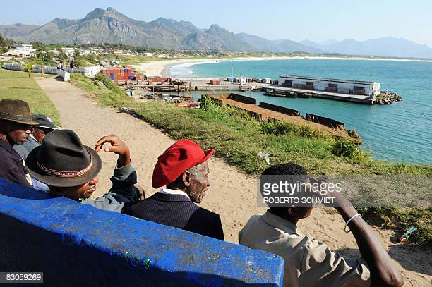 Residents of the southern Madagascan coastal town of Fort Dauphine 725 kms south of the capital Antananarivo sit on a bench overlooking the town's...
