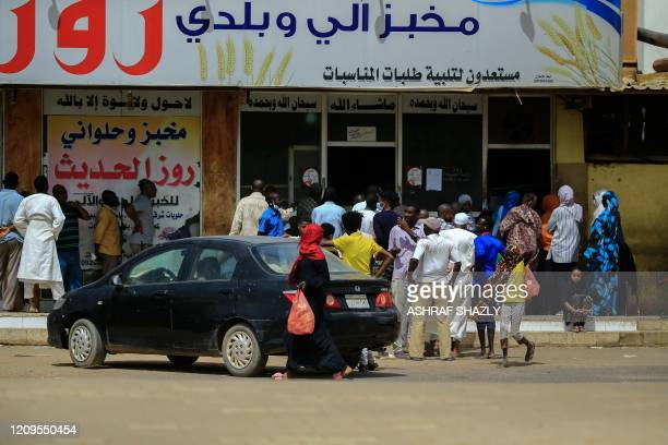 Residents of the Sudanese capital Khartoum queue in front of a bakery on April 9 2020 The Sudanese authorities yesterday announced a rise in the...