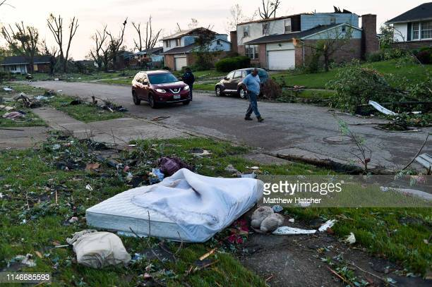 Residents of the Trotwood neighborhood West Brook inspect the damage to their homes following powerful tornados on May 28 2019 in Trotwood Ohio
