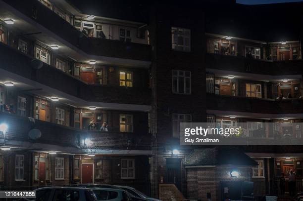 Residents of the Tulse Hill Estate applaud NHS staff and carers on April 2 2020 in London England The Coronavirus pandemic has spread to many...