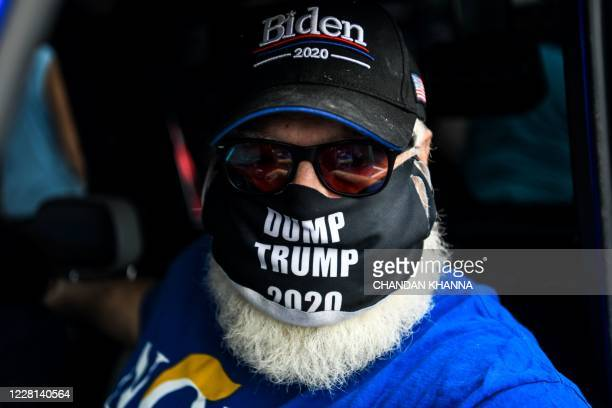 Residents of The Villages, Florida, take part in a golf cart parade on August 21 to celebrate the nomination of Joe Biden for Democratic presidential...