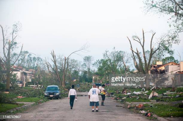 Residents of the West Brook neighborhood emerge from shelter to inspect the damage in their neighborhood after a suspected ef4 tornado touched down...