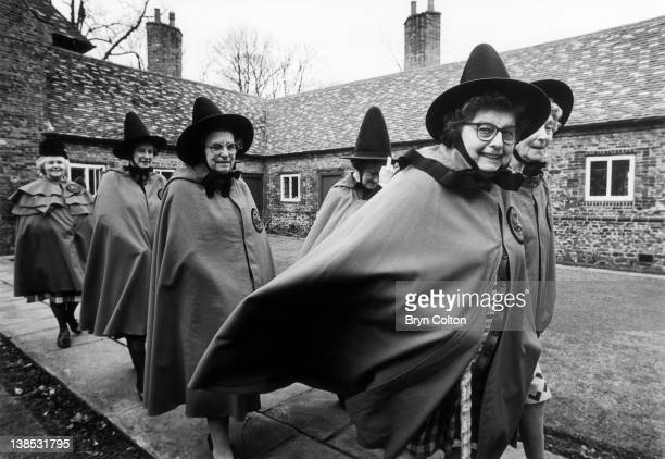 Residents of Trinity Hospital or Bede House walk from their Almshouses on their way to chapel to mark the hospital's 376th Founders Day in Castle...