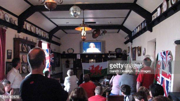 Residents of Wick in the Vale of Glamorgan South Wales fill local pub The Lamb and Flag to celebrate the gold medal won by Nicole Cooke in the...