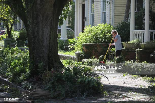 Residents of Wilmington clean up tree branch debris after Hurricane Isaias made landfall near the town the night before in Wilmington North Carolina...