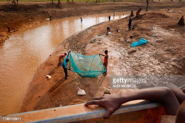 Residents of Yusuf Batir refugee camp fish together with the local host community at a stream formed as a result of intense flooding in Maban, South...