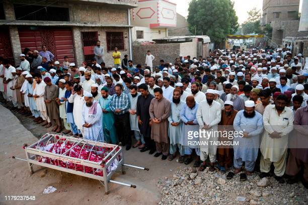 Residents offer a funeral prayer for a train fire victim in Mirpurkhas on November 1 a day after a passenger train caught on fire in Rahim Yar Khan...