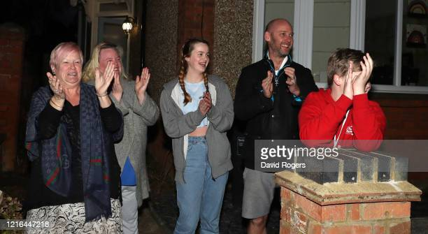 Residents on a Northampton street applaud the NHS staff and other key workers on April 02 2020 in Northampton United Kingdom Members of the public...