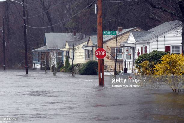 Residents on Moore and Perkins Street deal with flooded homes March 30 2010 in Cranston Rhode Island The second major rain storm of March hammered...
