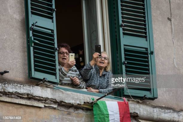 Residents on window and balconies during a flash mob launched across Italy to bring people together and try to cope with the emergency of the...