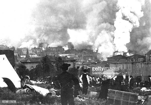 Residents overlooking downtown San Francisco as fires breakout across the city after the 1906 earthquake. The event that took place in 1906 measured...