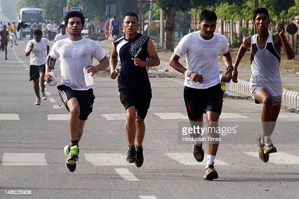 Residents participate Marathon Noida 10k from Ramleela Ground, Noida Stadium at Sector 21A on July 8, 2012 in Noida, India.
