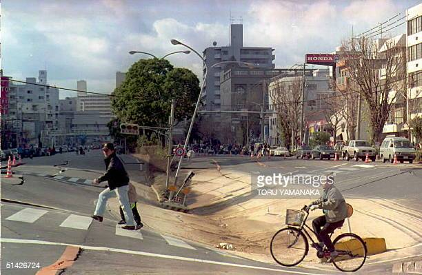 Residents pass 19 January over a dip in the road on Dikai Dori Street in Kobe city formed when the subway train tunnel collapsed underneath The...