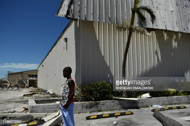 Residents pass damage caused by Hurricane Dorian on September 5 in Marsh Harbour Great Abaco Island in the Bahamas Hurricane Dorian lashed the...