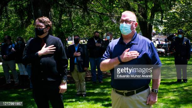 Residents pay their respects during the funeral of Glen Ridge Police Officer Charles Roberts after he passed away from the coronavirus on May 14 2020...