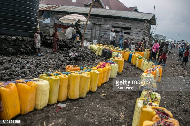 Residents placed their water containers to the water stand in Katoyi the outskirt of Goma on June 14 2014 in Goma Democratic Republic of Congo...