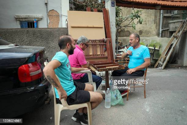 Residents play a game of backgammon in a residential street near the Port of Beirut in Beirut, Lebanon, on Wednesday, Aug. 12, 2020. Lebanon was...